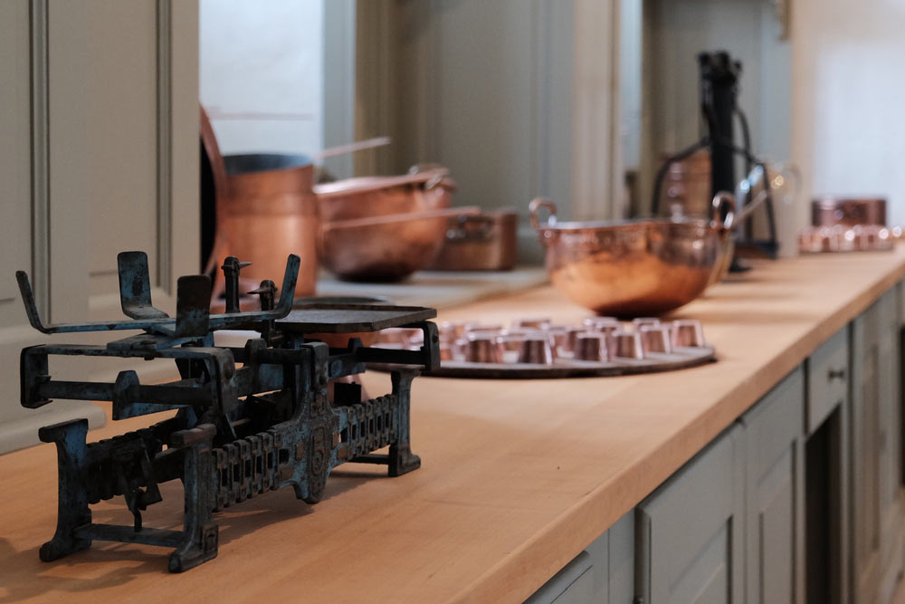 Copper pans and other utensils on an Edwardian style Kitchen counter
